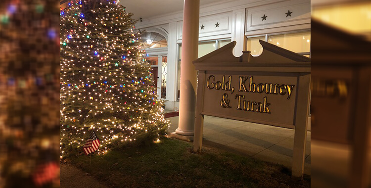 Gold, Khourey & Turak Christmas Tree and Entrance Sign